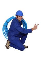 Happy plumber, studio shot