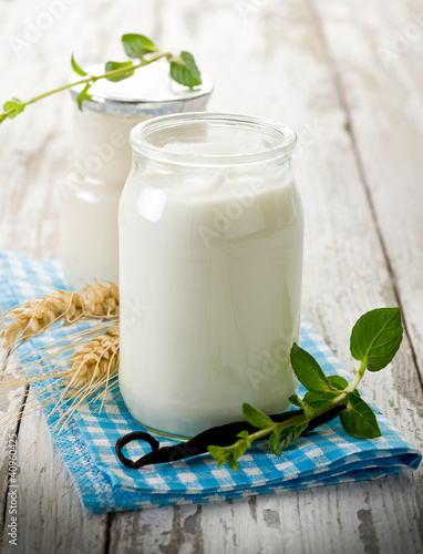 yogurt with vanilla stick and mint leaves