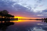 summer lake sunset. Boats sky reflections water