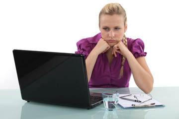 Frustrated woman staring at her laptop