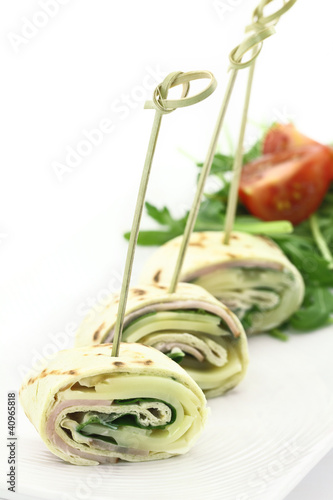 Tortilla stuffed with cheese and ham
