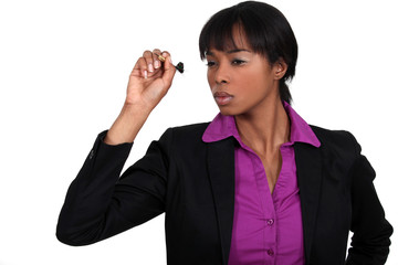 Businesswoman throwing dart