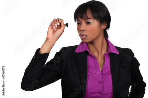 Businesswoman throwing dart