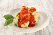 single plate with ravioli and basil