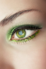 eye of woman with green make-up