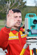 One surveyor worker working with theodolite