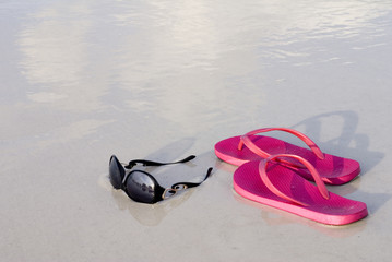 Flip Flops and Sunglasses on Beach