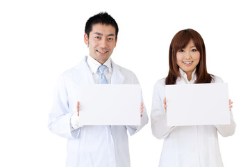 asian doctor holding a blank whiteboard