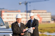 Architect man make notes on construction site