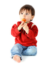 Child eating a rose