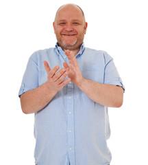 Charismatischer Mann klatscht in die Hände