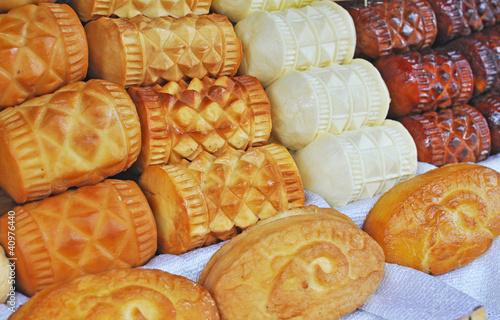 Traditional Polish smoked cheese known as oscypek - 40976440