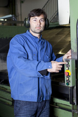 Metalworker pushing the button