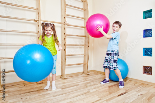 Boy and girl playing with balls