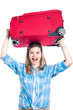 Happy traveller woman with luggage