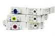 Used coloured ink printer cartridges on a white background