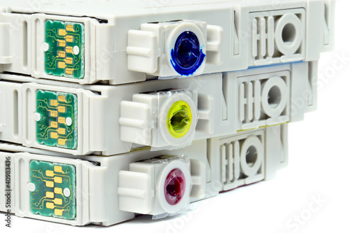 Close up of used coloured ink printer cartridges with chips