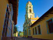 Colorful street and church in the town of Trinidad in Cuba