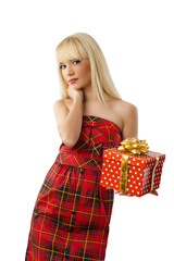 Beautiful young blonde girl holding christmas gift in red dress