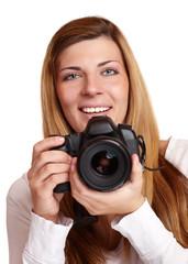 Junge Frau mit digitaler Spiegelreflexkamera