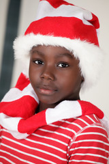 Christmas boy a cute african child in Santa cap
