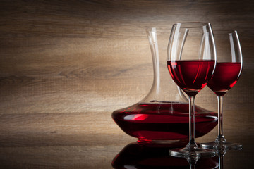 two Wine glass and decanter on a wooden Background
