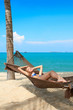 Woman enjoying the serenity of a tropical beach