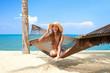 Vivacious beautiful woman in hammock