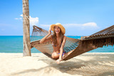 Vivacious beautiful woman in hammock - Fine Art prints