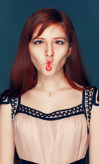 redheaded girl in a pink dress and hamming lips twist