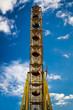 Amusement park with ferris wheel in summer