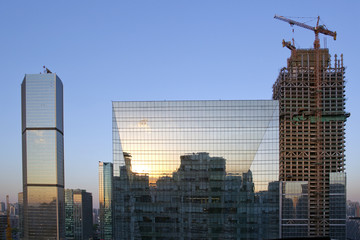 Sunset reflections in office building, Beijing, China