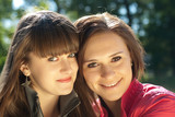 Two happy young women headshot