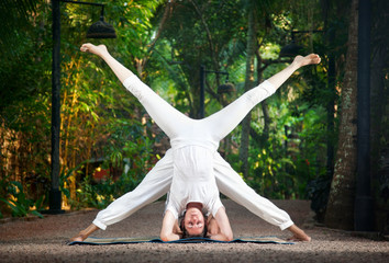 Couple yoga head stand pose