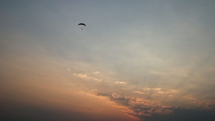paraglider activity fly with beautiful sunset background