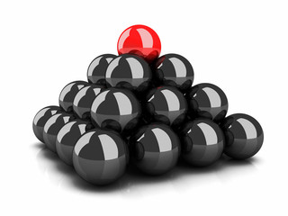 Pyramid of black spheres and top red sphere leader