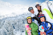 Family of four people at the mountain in winter