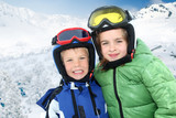 Portrait of children in ski outfit at the mountain