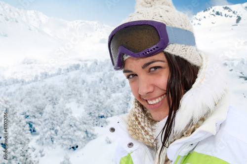 Portrait of woman at the mountain in ski outfit