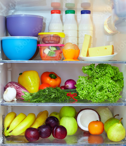 refrigerator full of healthy fruits, vegetables and dairy - 41003873