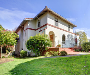 Spanish style white large home front exterior.