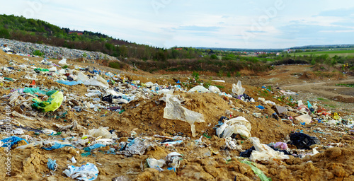 ecology disaster. land polluted with plastic bags and waste