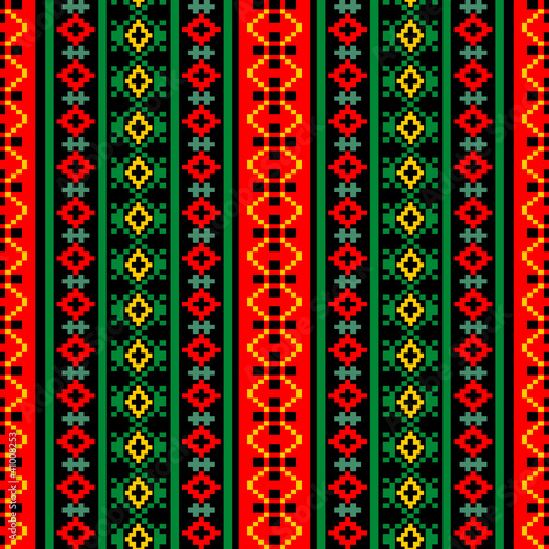 Bright textile ornamental seamless pattern at black background - 41008253