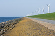 Endless dike with windmills in the Netherlands.