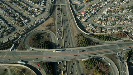 Aerial view of suburban traffic on a busy freeway