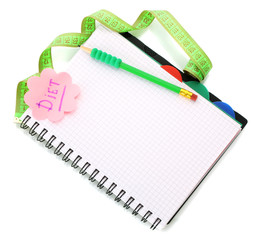 Planning of diet. Notebook measuring tape and pencil isolated