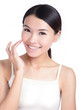 Young Girl Smile touch face with health skincare