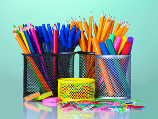 Colored holders for office supplies with them