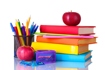 Composition of books, stationery and an apples isolated on white