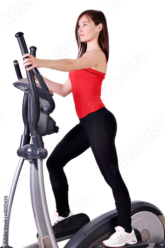 girl fitness exercise with cross trainer